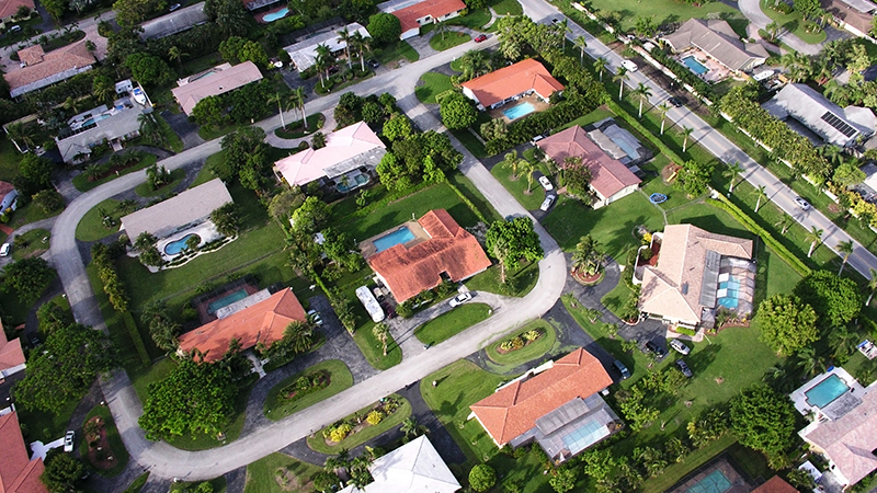 Aerial drone view of a Florida neighborhood inspection service
