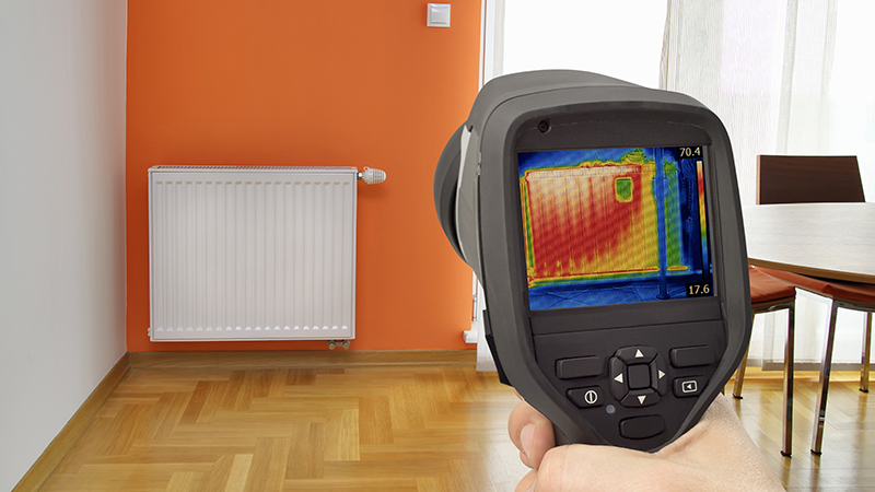 Thermal imaging camera being used while preforming inspection services to detect heat loss